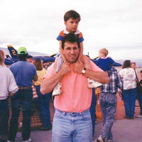 Young Kyler Fisher and his father