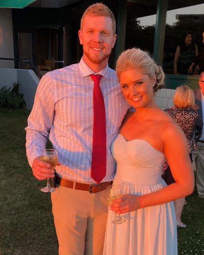 Claire with her husband on her friend's wedding