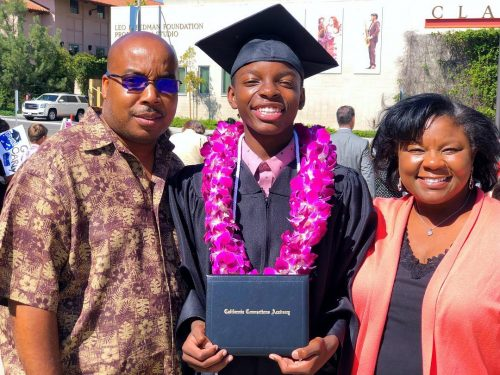 Will Simmons with his mother and father on his graduation day