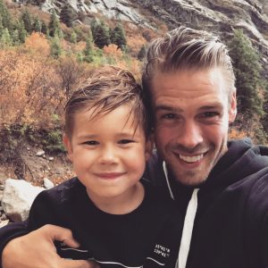 Kelsey Wells's husband with their son