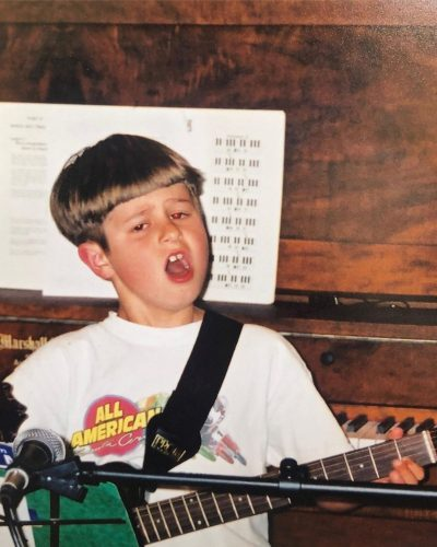 Oliver Tree playing guitar when he was a kid