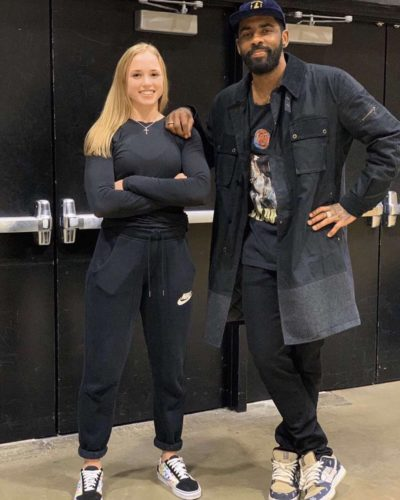 Hailey Van Lith with professional basketball player Kyrie Irving