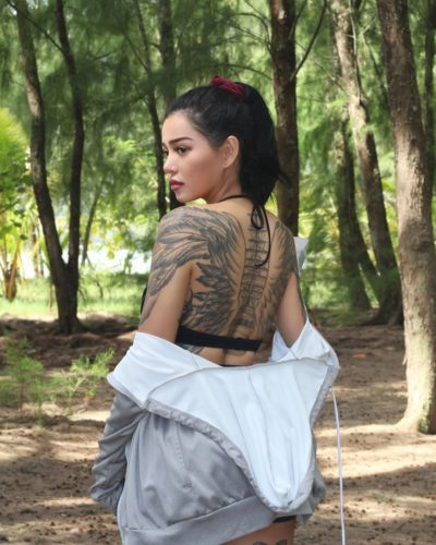 Bella Poarch showing off her back tatto