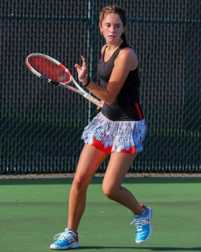 Mackenzie Raine playing tennis