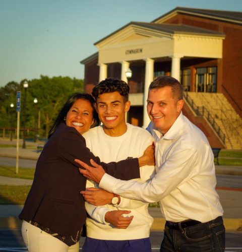 Christian Reyes with his parents