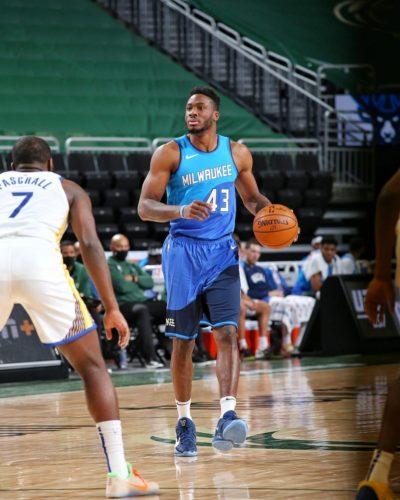 Thanasis playing basketball for his team