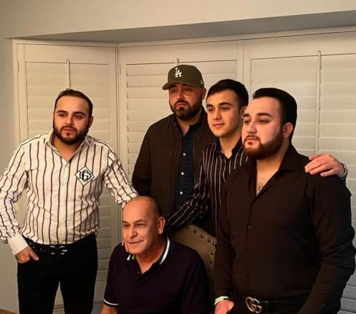 Kevin Ortiz with his father and brothers