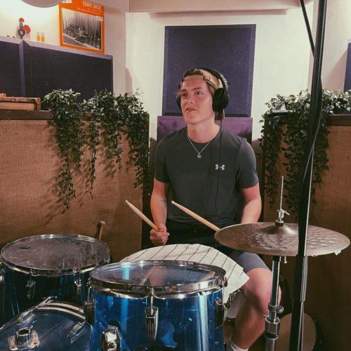 Reece Bibby playing drum