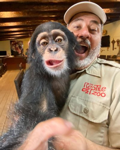 Jay Brewer with a chimpanzee