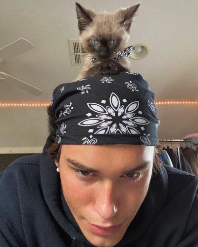Broghan Semrad with his pet cat