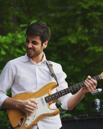 Emiliano Santoro with a guitar