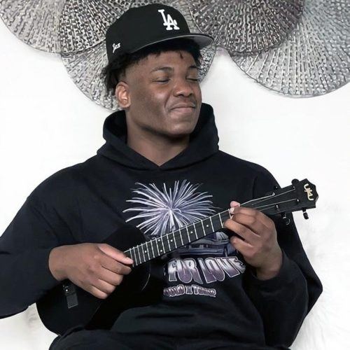 Jex Nwalor with a guitar