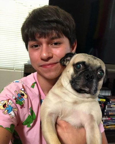 Mikey Angelo with his pet dog