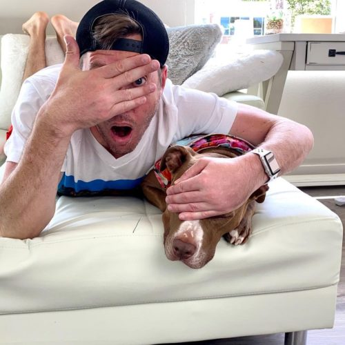 Robby Cole having fun with hsi pet