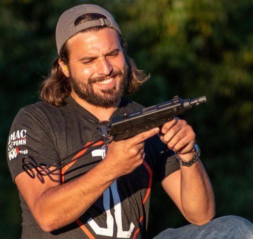 Brandon Herrera with a gun