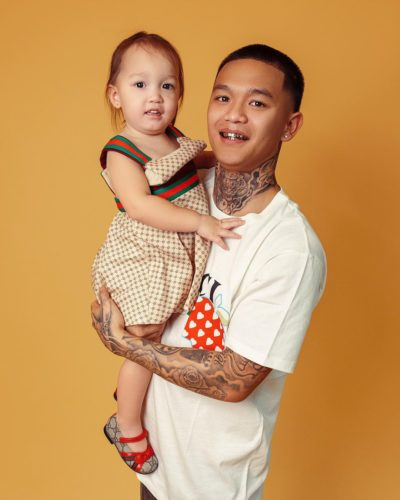 Huey Ha with his daughter