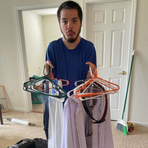 Martin arranging his clothes