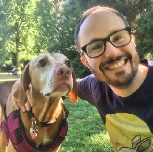 Matt Baume with a dog