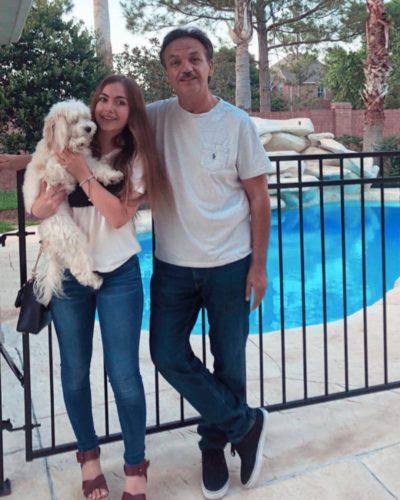 Nourxturki with her father